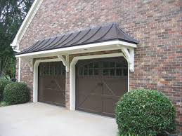 metal car porch metal roof bracket portico over double garage doors designed and