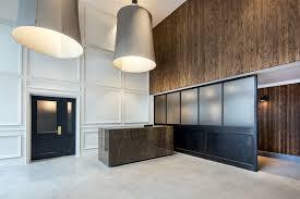 Desk Molding High Ceilings Lobby Poured Concrete Floors Over Sized Custom