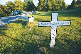 roadside memorial crosses flowers flags cross taken from roadside tribute to hton