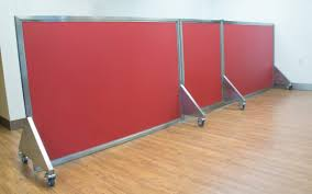 our dog day care equipment includes colorful kennel room dividers