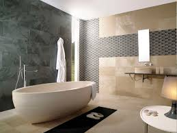 beige small freestanding bathtub on beige tile floor connected by