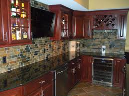 cherry cabinets granite countertops natural slate backsplash