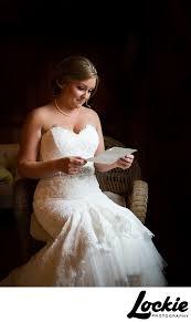 wedding gift opening opening gift from groom wedding photographers wedding