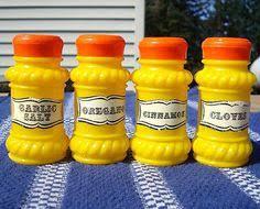 sunflower kitchen canisters retro set 4 yellow spice jars shakers orange lids plastic vintage