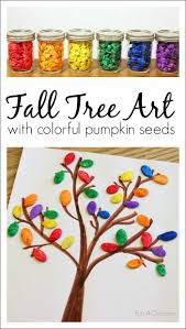 fall art for kids using colorful pumpkin seeds fall trees and