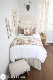 chic boho dorm room bedding with a rustic flair tan cowhide
