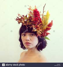floral headdress portrait of a woman wearing a floral headdress stock photo