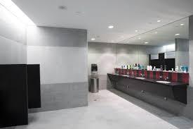 light coloured tile band floor and wall the same high backsplash