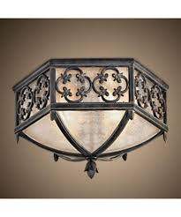 Shown In Wrought Iron Finish And Subtle Iridescent Textured Glass