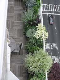 modern balcony planters rooftop garden love the wood and the plants along railing