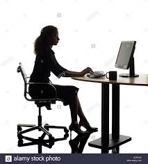 Business Computer Desk Business At Desk With Computer Screen Silhouette Stock Photo