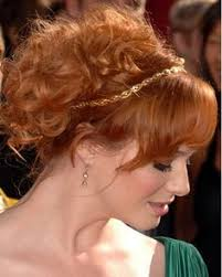 hairstyles that have long whisps in back and short in the front the short and short of emmys hair last night christina hendricks