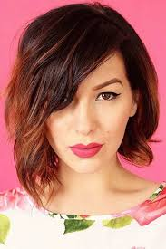 a symetric hair cut round face side swept bangs for a round face shape hair world magazine