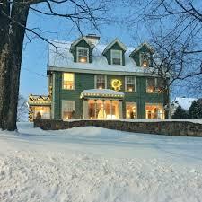 perfect little house winter light tour bright green door