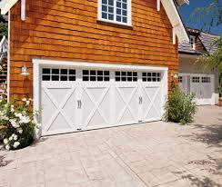 garage with living space above clopay coachman collection carriage house garage doors on a