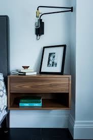 best 25 blue bedside tables ideas on pinterest bedside table design dozen 12 clever space saving solutions for small bedrooms a nightstand that mounts on the wall is perfect for a small bedroom