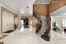 foyer in luxury home with curved staircase stock photo picture