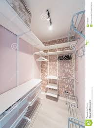 small modern dressing room made in pink with hangers royalty free