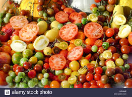 variety of fresh vegetables colored tomatoes red yellow and