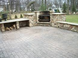 Concrete Patio Color Ideas by Cobblestone Stamped Concrete Patio With Outdoor Cooking Fireplace
