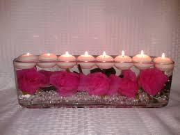 Long Vase Centerpieces by Roses And Pearls Floating In A Long Vase With Floating Candles