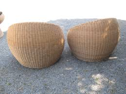 vintage pair of wicker chairs and table in the style of eero