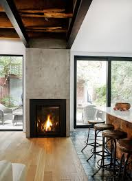 retro wood burning fireplace designed between glass sliding doors