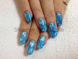 gel nails oval shaped nails blue gel holographic blue foil