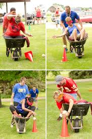 adults and kids compete in a variety of backyard games including