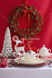 festive and white table setting with china
