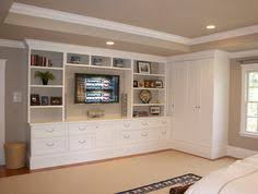built in cabinets bedroom love this idea built ins to hide the tv in the bedroom plus the