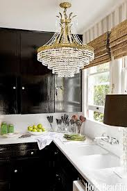 Black Lacquer Kitchen Cabinets by Kitchen Has A Chandelier Bamboo Blinds Black Lacquered Kitchen