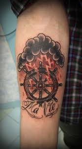 wheel lightning tattoo designs for men on arm tribal lightning