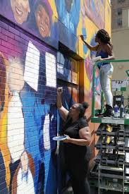 aclu protest mural unveiled in downtown raleigh news observer artist dare coulter top and her mother anita coulter paint a mural of protestors as part of an aclu commission on the back of a building on salisbury st