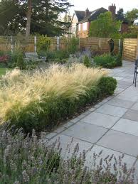 large patio area paved in silver birch sandstone with matching