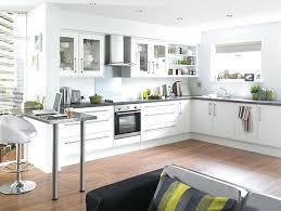 white kitchen cabinets with light wood floors black grey hardwood