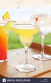 margarita with variety of summer cocktails by the poolside stock