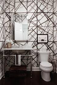 white and black powder room with groundworks channels wallpaper