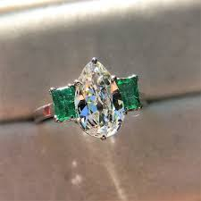 1 27ct art deco pear cut diamond and emerald trilogy ring gia h