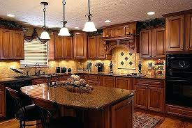 kitchen paint colors with oak cabinets and black countertops for