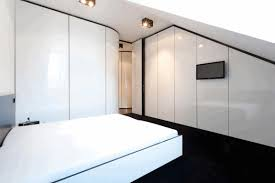 jet black floor smooth glowing white wall black and white bedframe