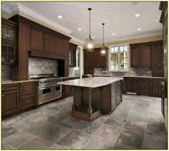 modern kitchen with floating cabinets and porcelain floor tiles