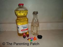 sensory bottle ideas oil water and plastic baubles parenting