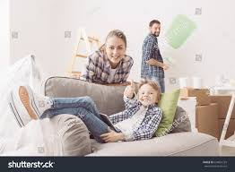 Their Home by Happy Family Renovating Their Home They Stock Photo 634841729