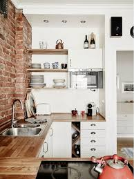 brick tiny house kitchen tiny brick kitchen wall with storage system 20
