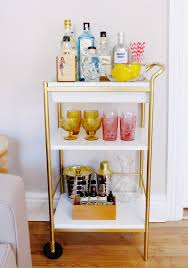 our favorite blogger bar carts the lemons gold bar cart and crates bar cart style tips on styling and stocking a home bar