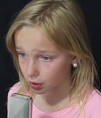 11 year old girl talented 11 year old girl sings into mic her voice captures the