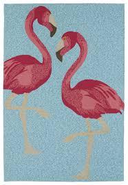 flamingos in blue area rug