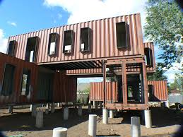 unfinished brown container homes design with robust elbows and