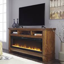 ashley furniture ralene xl tv stand with fireplace in medium brown